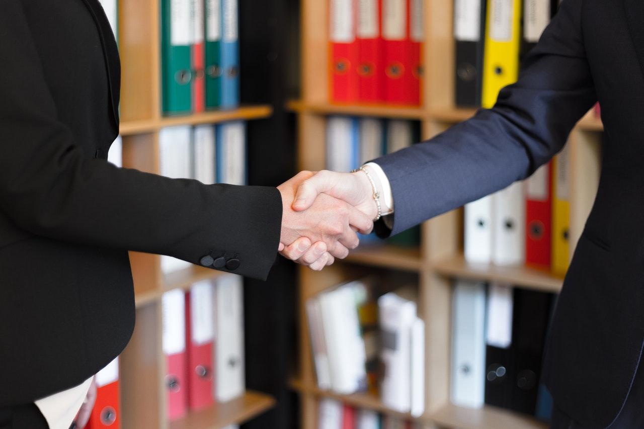 business handshake man woman