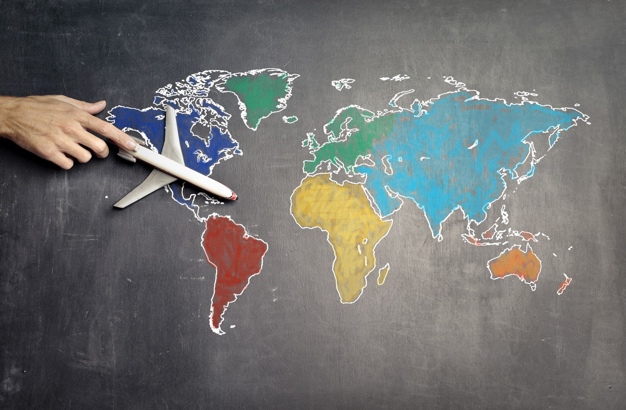 chalk world map with a plane