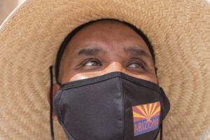 man with arizona flag face mask